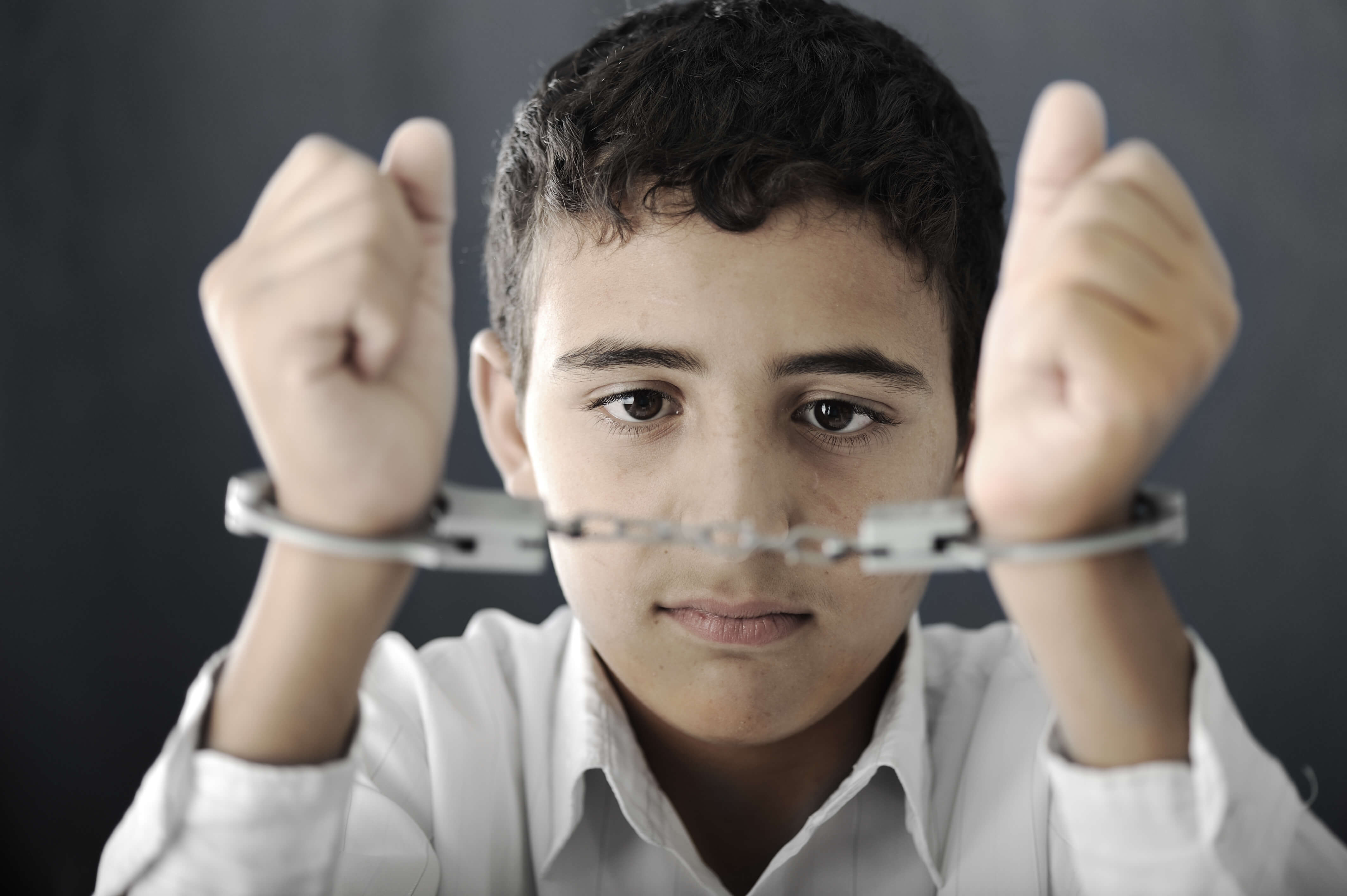 Child in handcuffs - juvenile criminal charges